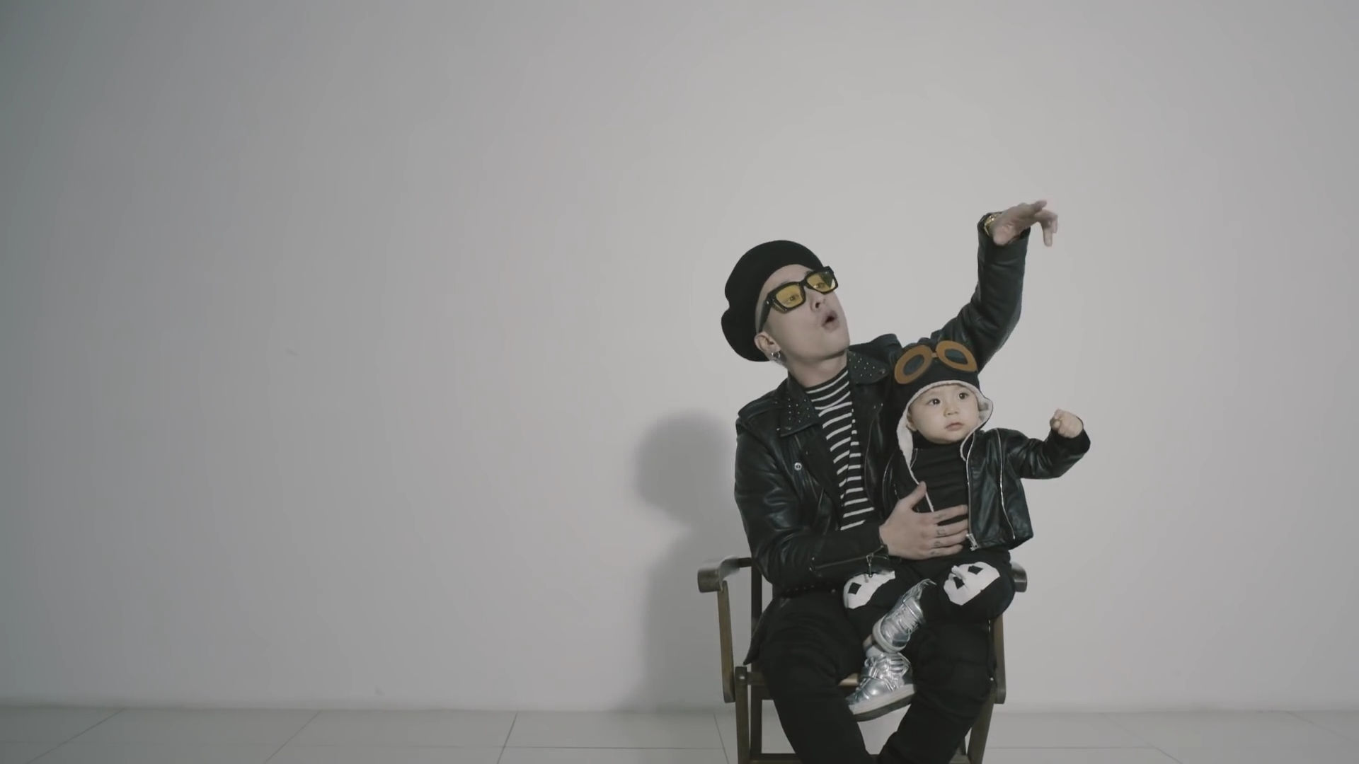Hold up! Babies don't belong in a rap music video.